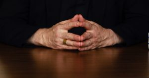 Image: two hands clasped together